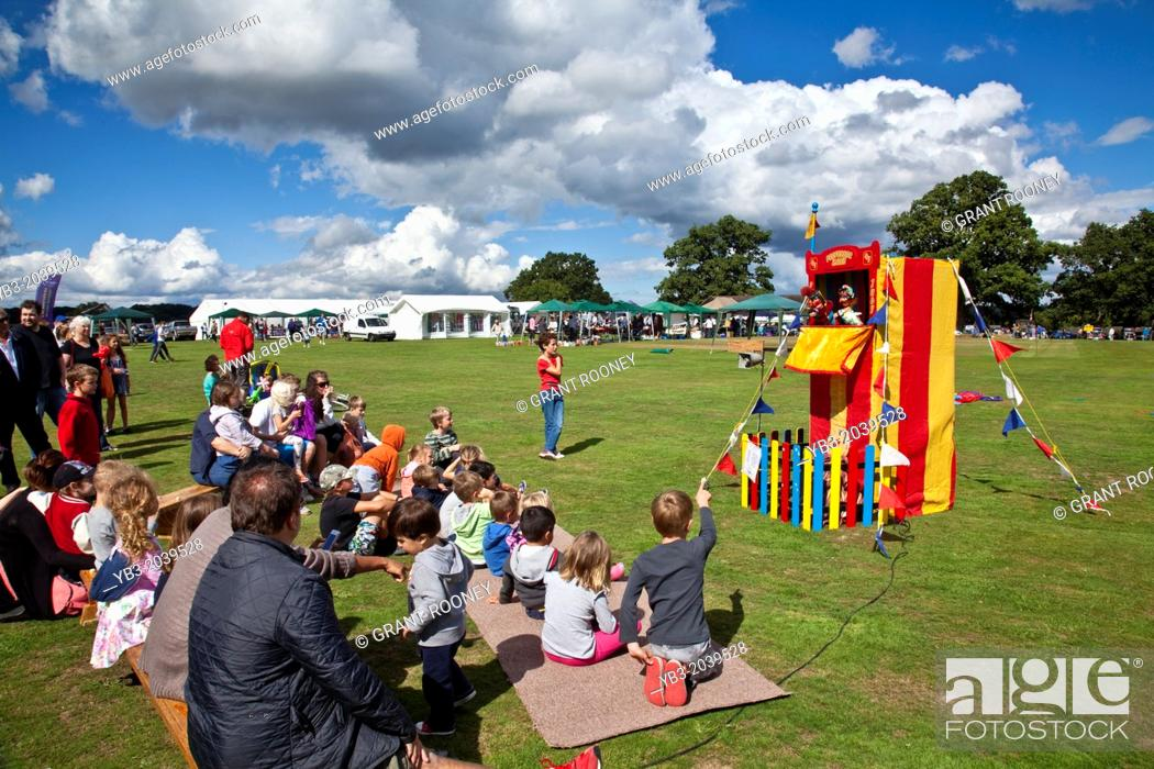Stock Photo: A Traditional Punch and Judy Show, Hartfield Village Fete, Hartfield, Sussex, England.