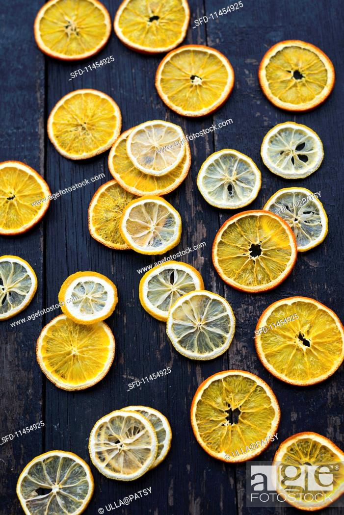 Stock Photo: Dried citrus fruit slices on a wooden background.