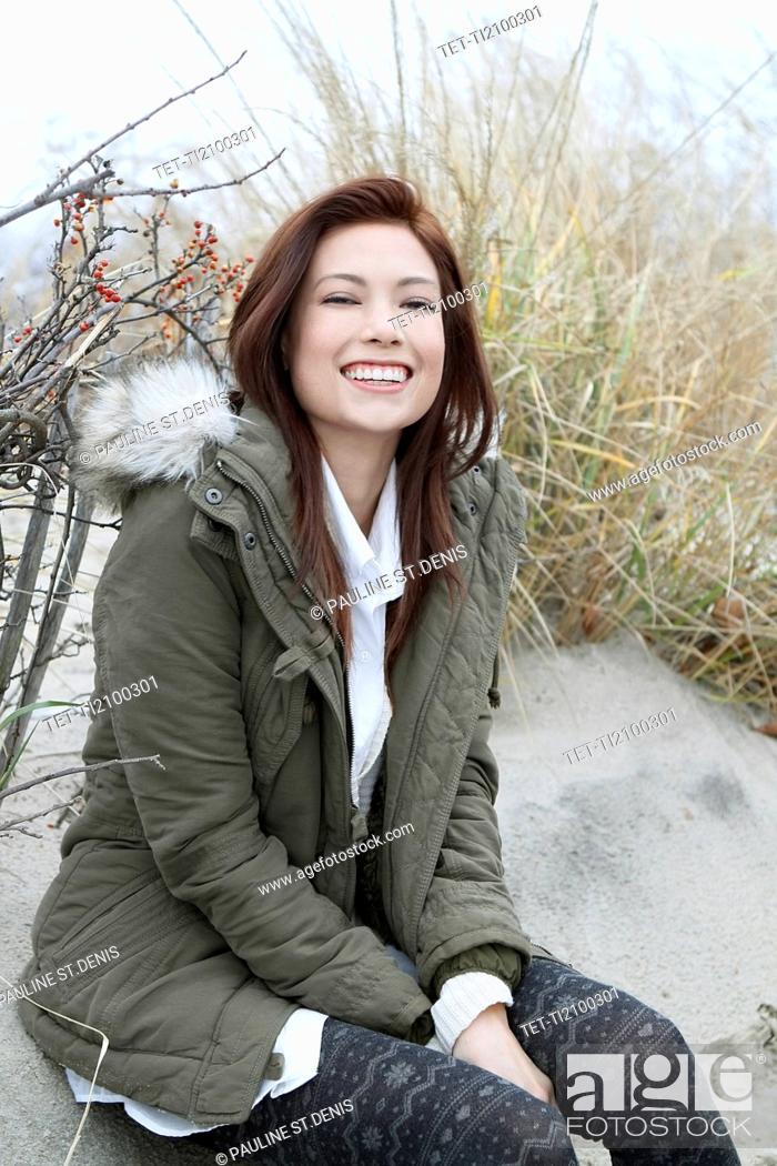 Photo de stock: Portrait of woman in parka on winter beach.