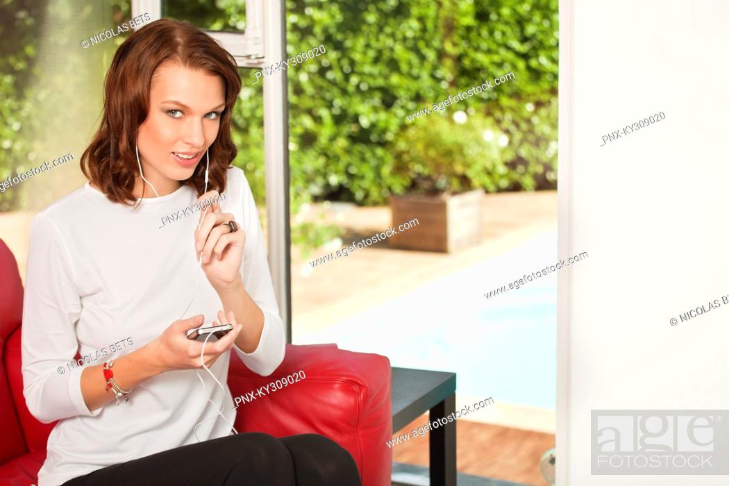 Stock Photo: Young woman using iPhone.
