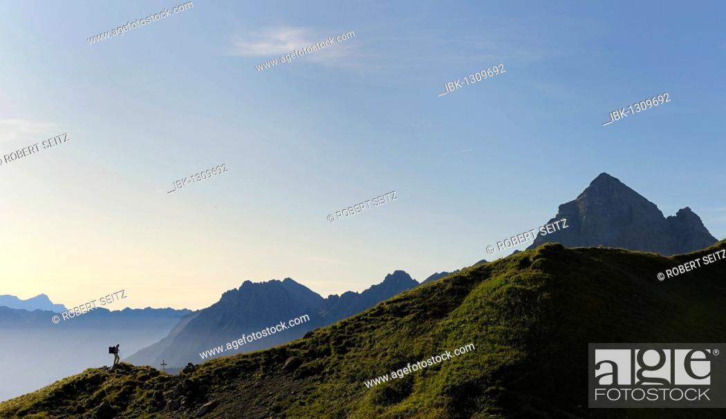Stock Photo: Mountaineer in front of mountain ridge in the morning light, Hinterhornbach, Lechtal, Ausserfern, Tyrol, Austria, Europe.