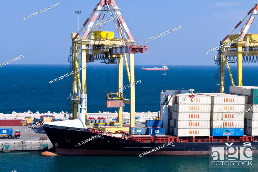 Stock Photo: Loading a container ship in Port Sultan Qaboos in the city of Muscat Oman.