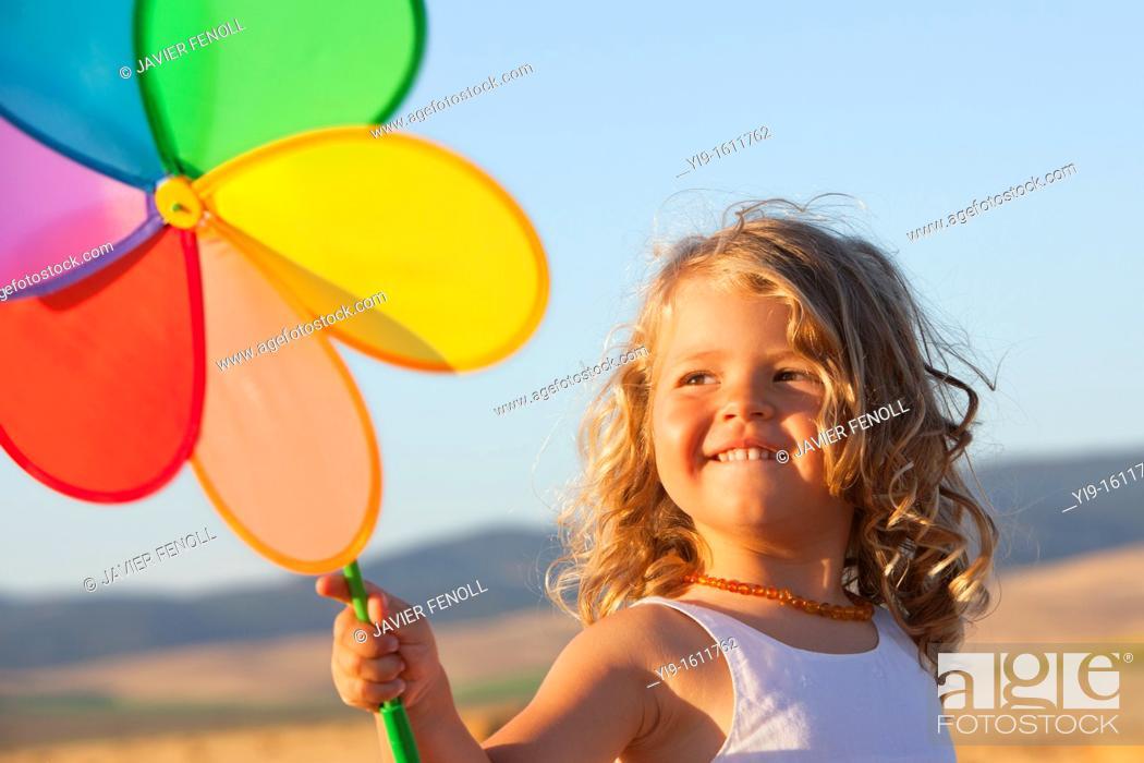 Stock Photo: girl with pinwheel.