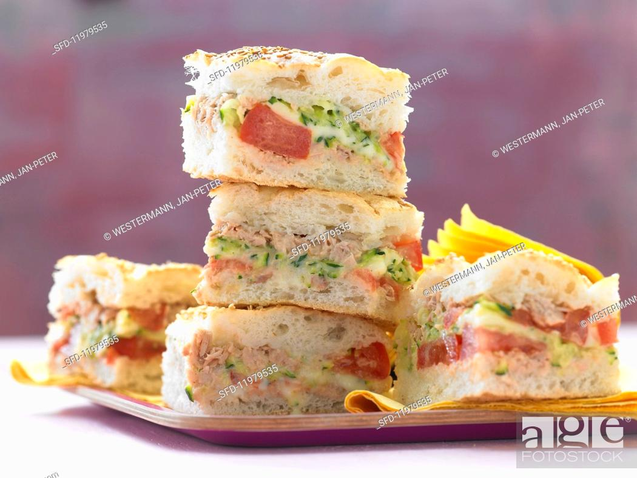 Stock Photo: Stuffed unleavened bread with tuna fish, tomatoes and courgettes.