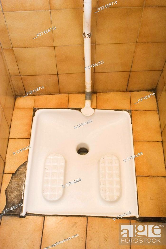 Stock Photo: French squat toilet, used by squatting, rather than sitting.