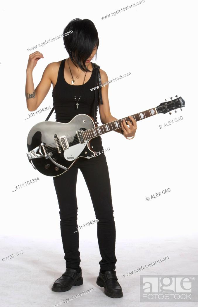 Stock Photo: Young woman with electric guitar.