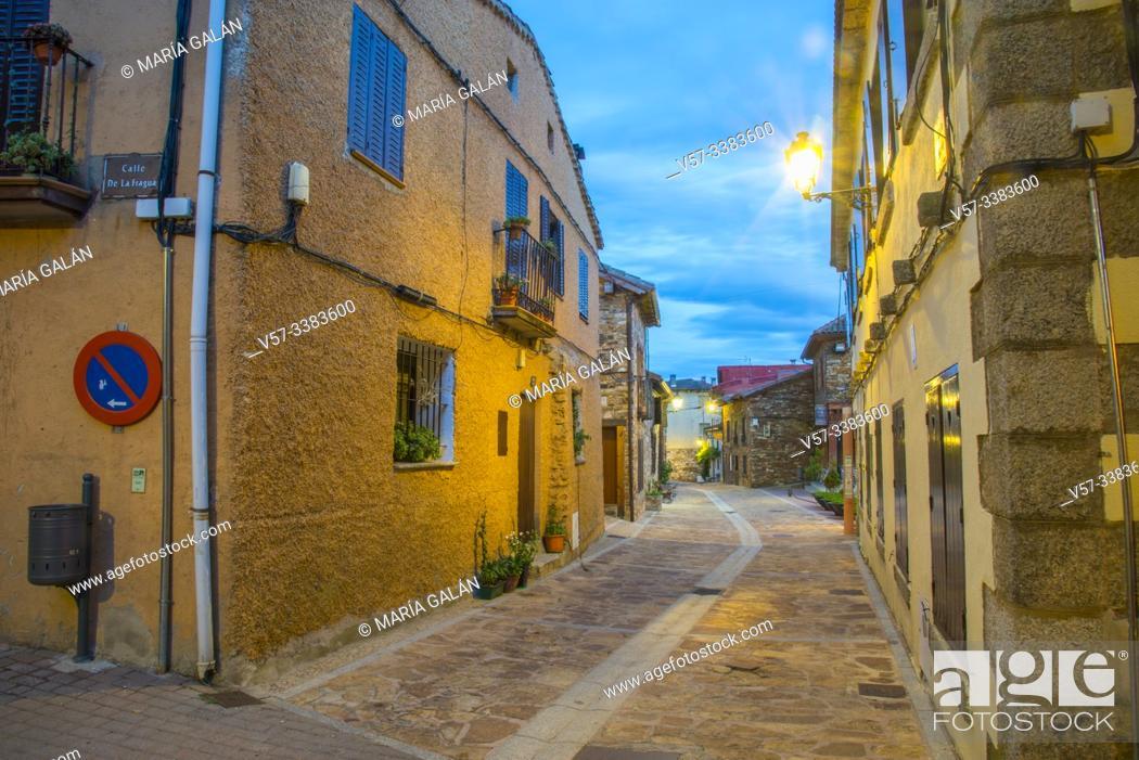 Stock Photo: Main Street at nightfall. Puebla de la Sierra, Madrid province, Spain.