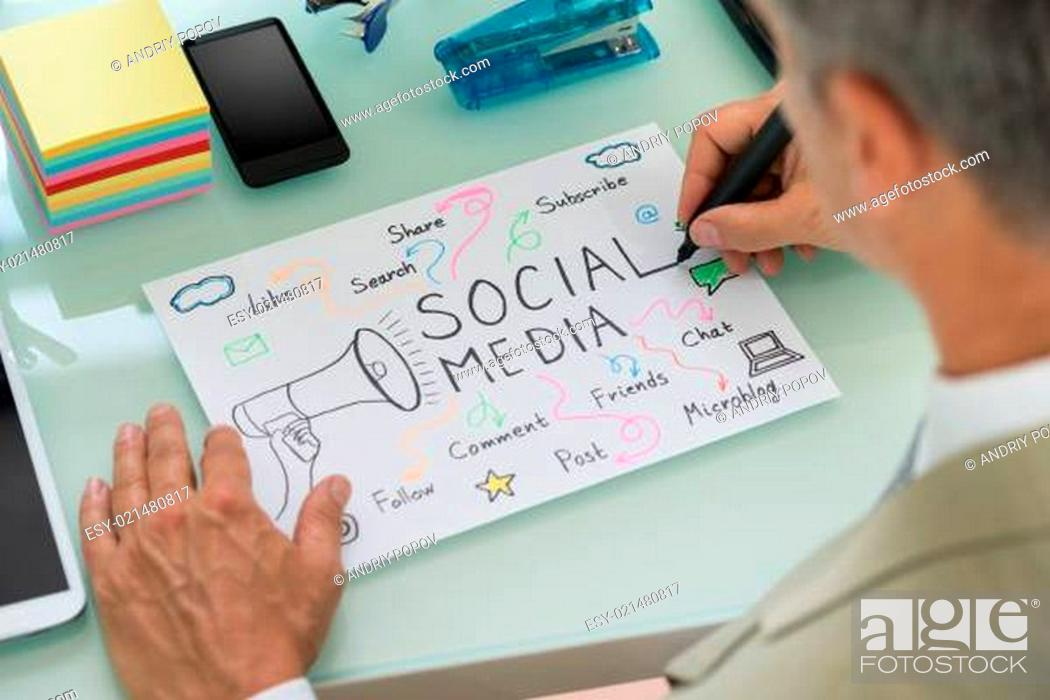 Stock Photo: Close-up Of Businessman Planning Social Media Strategy On Paper. Diagram was created by photographer.