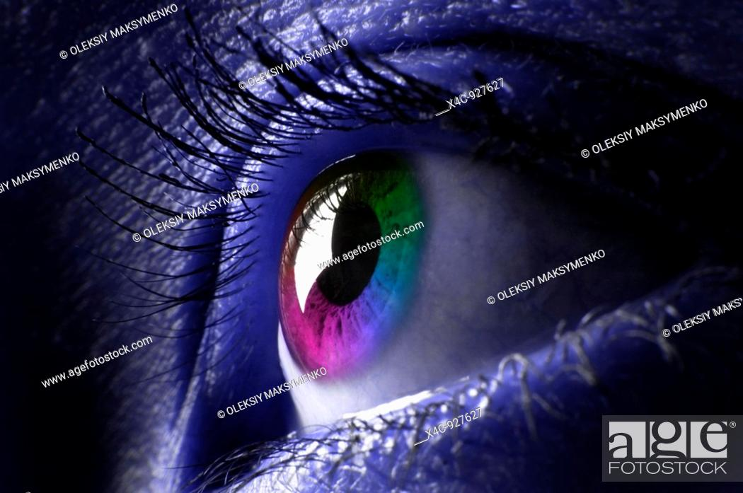 Stock Photo: Closeup of a colorful womans eye.
