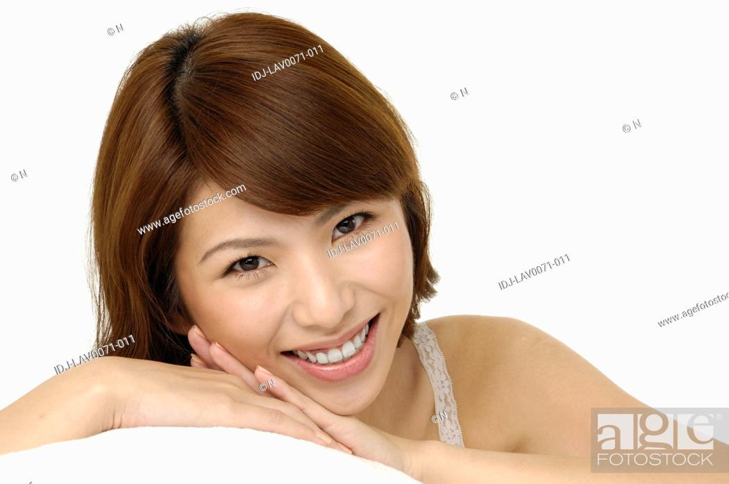 Stock Photo: Portrait of a fresh and lovely woman smiling.