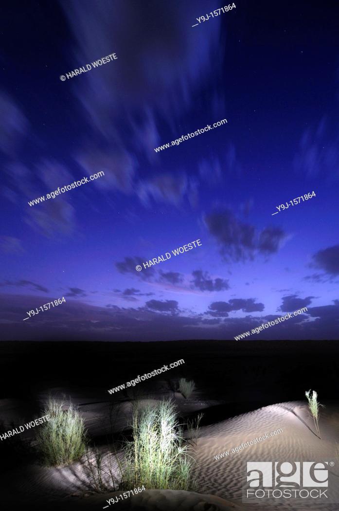 Stock Photo: Africa, Tunisia, Tembaine  Artificial floodlight illumination in the Sahara desert.