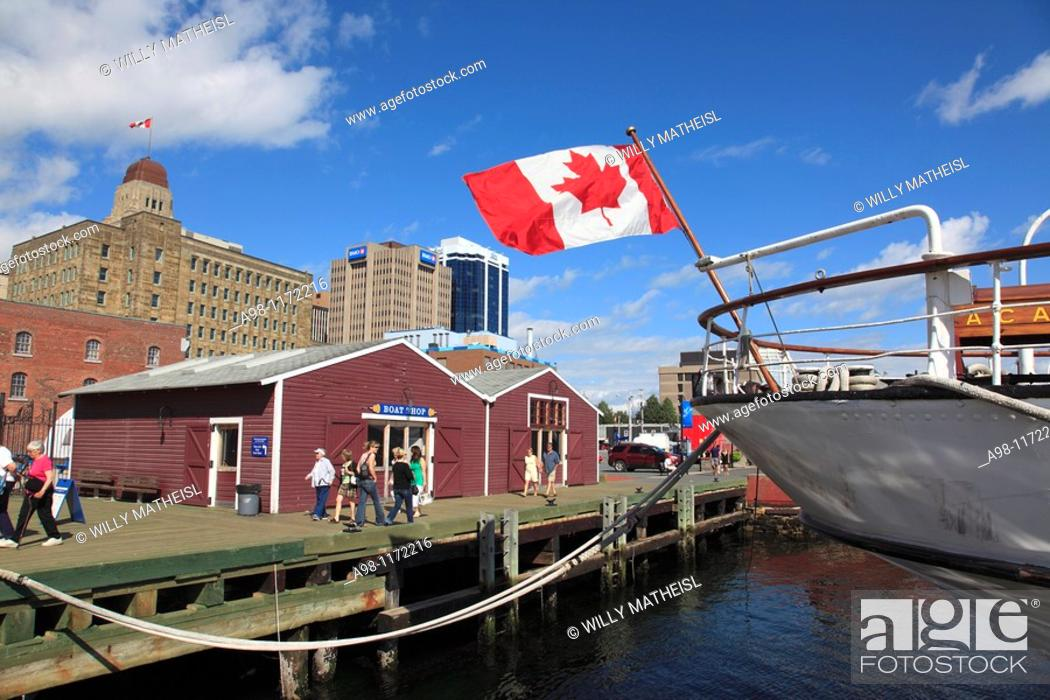 Stock Photo: boat with flying Canadian Flag mooring at the Harbour Walk of Halifax, Nova Scotia, Canada, North America.