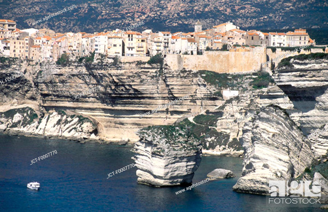 Stock Photo: France, Corsica, Bonifacio, village by cliffs.