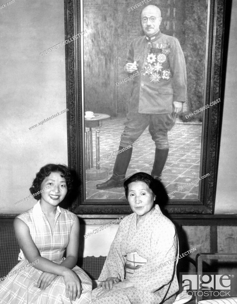 Stock Photo: Kimiye Tojo, 26, with her mother, Katseko, before a painting of Japanese Premier Hideki Tojo. Tojo's daughter, Kimiye was offered a scholarship by the Portia.