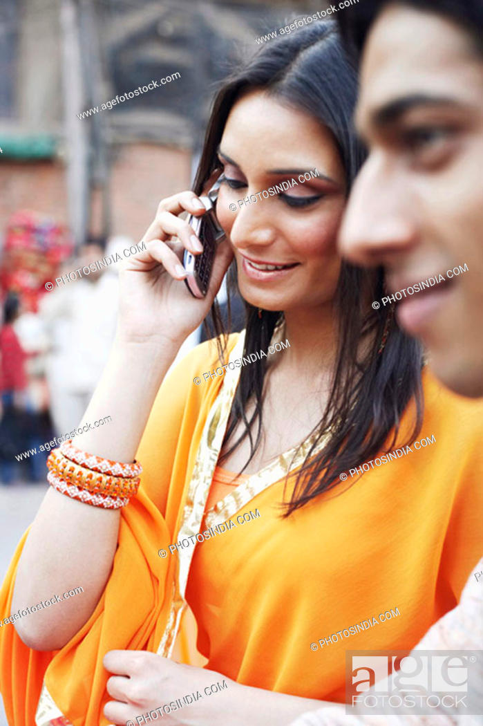 Stock Photo: Close-up of a young woman talking on a mobile phone.