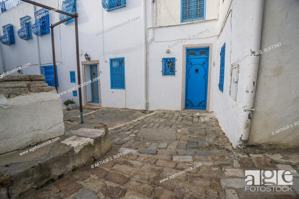 Stock Photo: The cobbled streets of Sidi Bou Said. The blue and white tourist attraction overlooking the Mediterranean Sea. Tunisia, Africa.