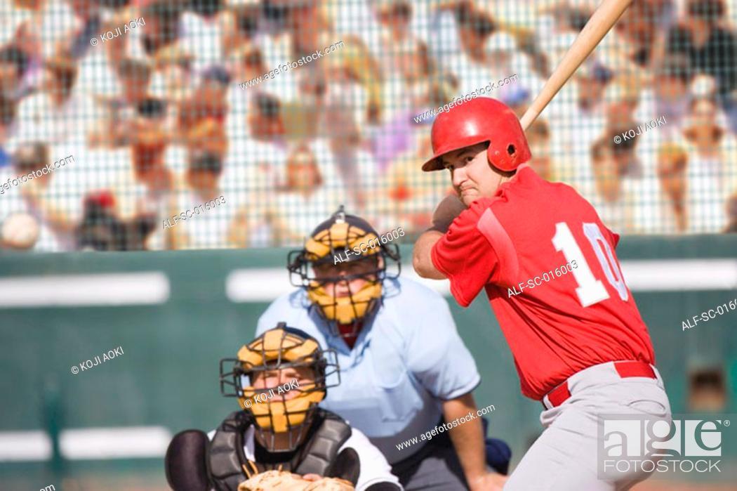 Stock Photo: Baseballball player preparing to swing.