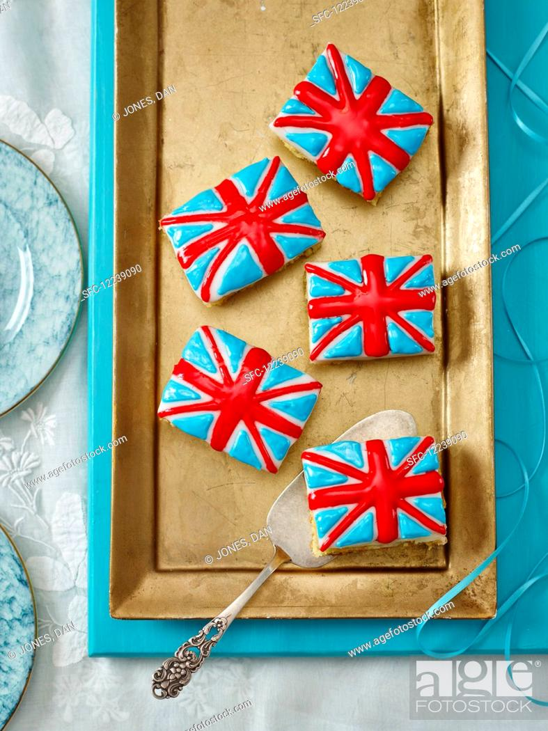 Stock Photo: Union Jack cakes on a golden cake tray (seen from above).