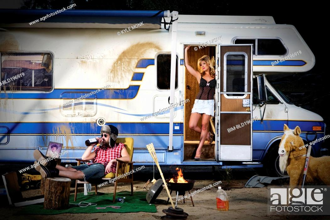 Photo de stock: Couple vacationing in recreational vehicle.