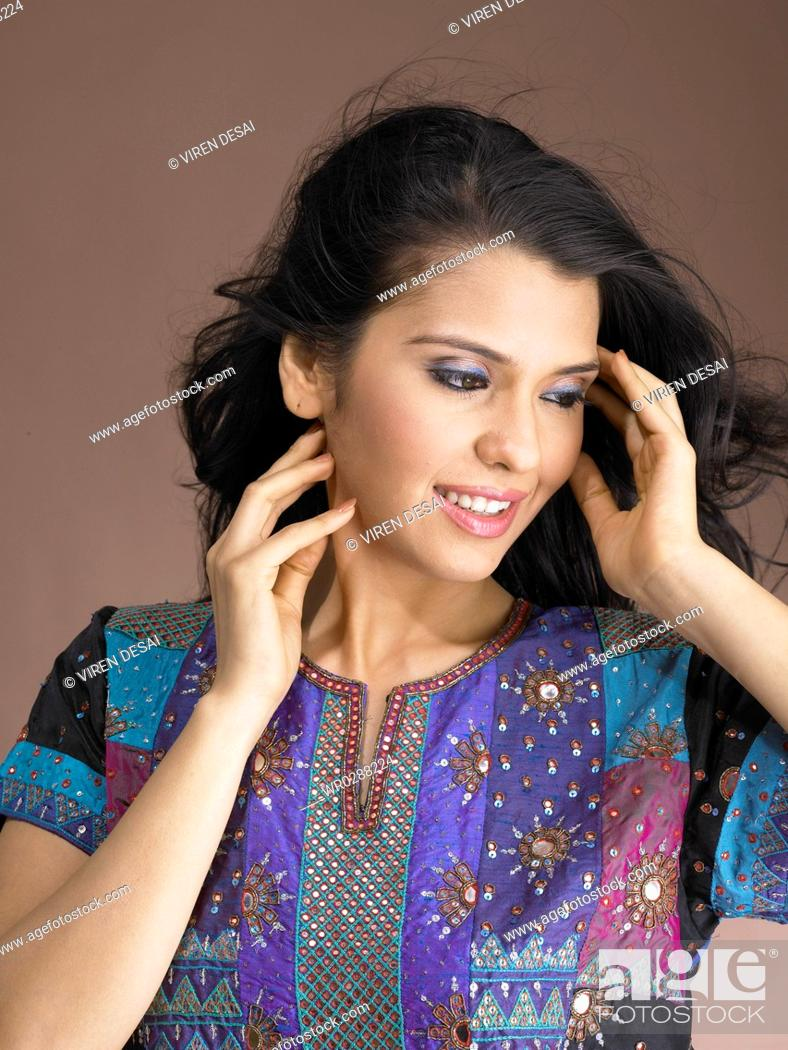 Stock Photo: South Asian Indian woman smiling standing in stylish pose and looking at camera MR 702.