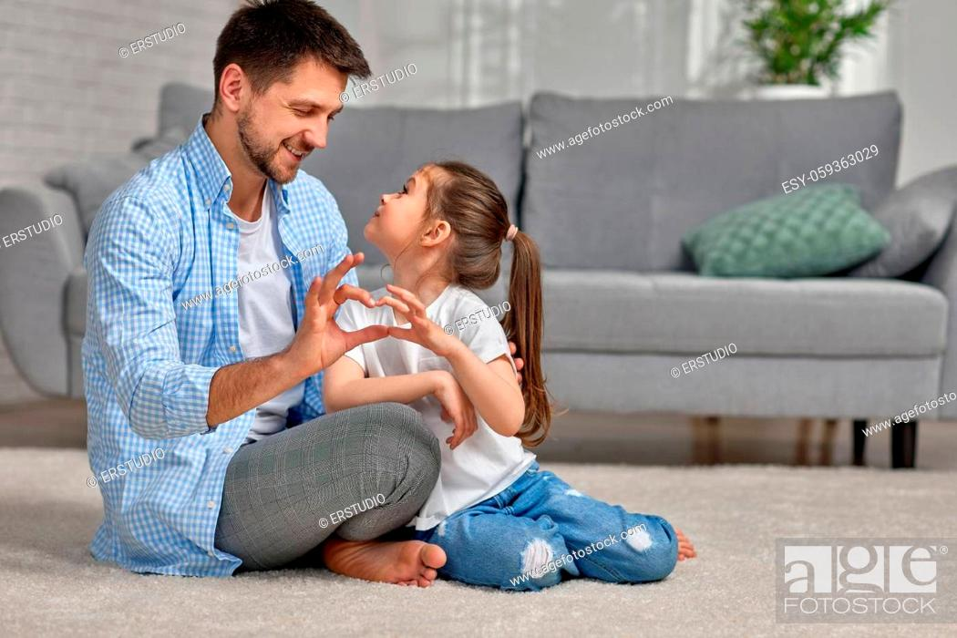 Stock Photo: handsome father and cute little child daughter showing love sign. dad and girl kid make hand heart gesture. Happy Father's day.