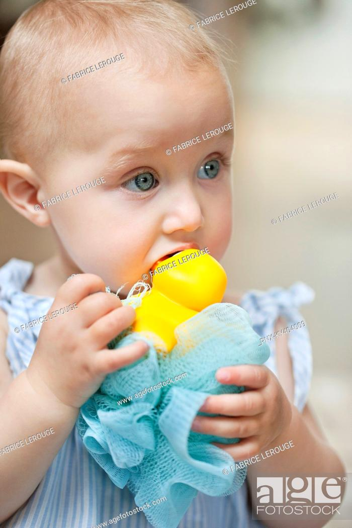 Stock Photo: Close-up of a baby girl playing with a toy.