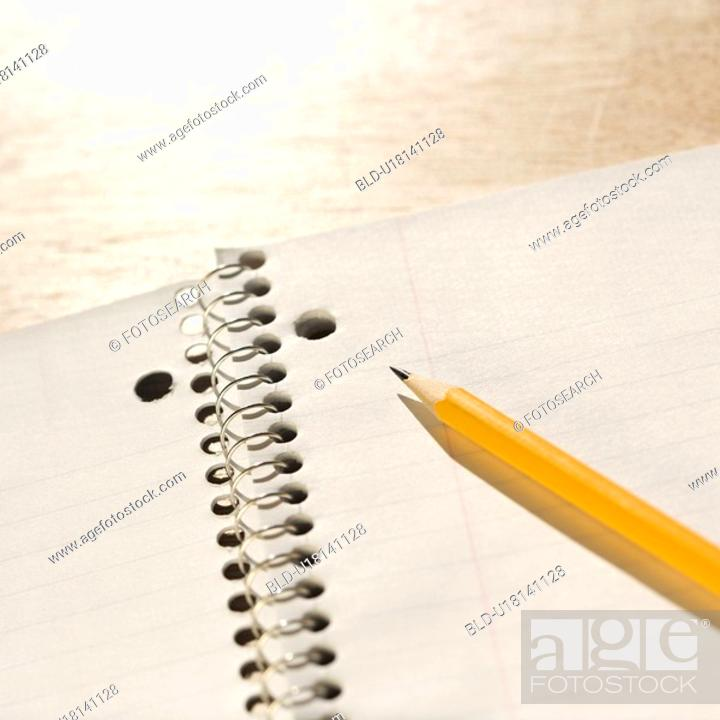Stock Photo: Pencil on top of spiral bound notebook.