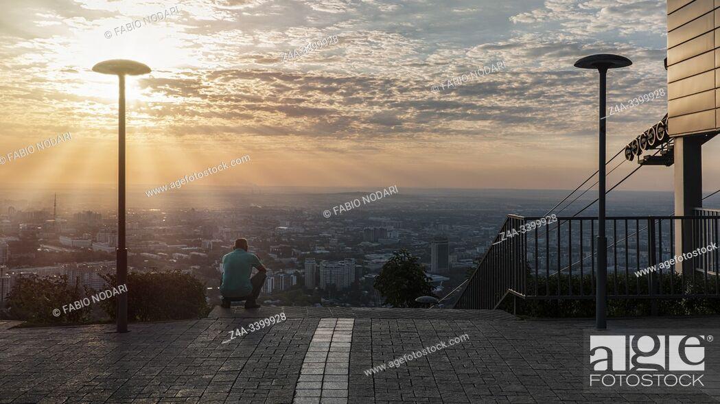 Stock Photo: Almaty, Kazakhstan - August 8, 2019: Kok Tobe at sunset. Kok Tobe is a mountain in Almaty, Kazakhstan's largest city.