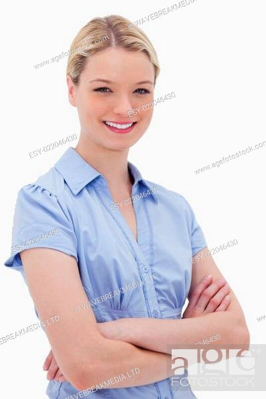 Stock Photo: Smiling woman standing with arms folded.