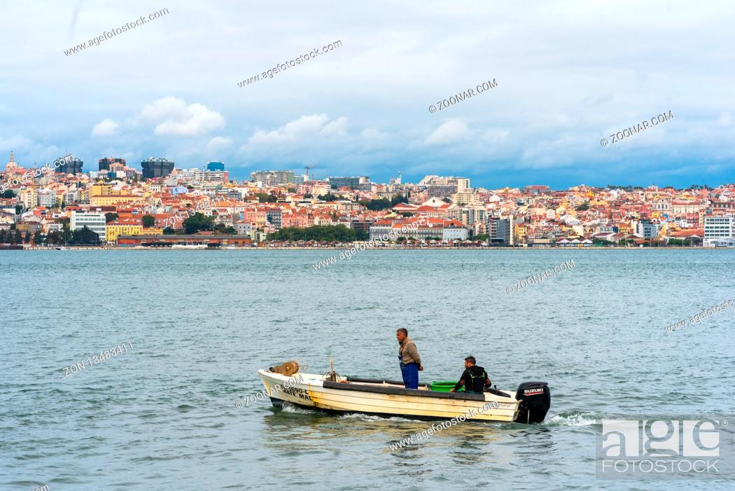 Stock Photo: View from riverbank at Cacilhas over the Tagus river to Lisbon.