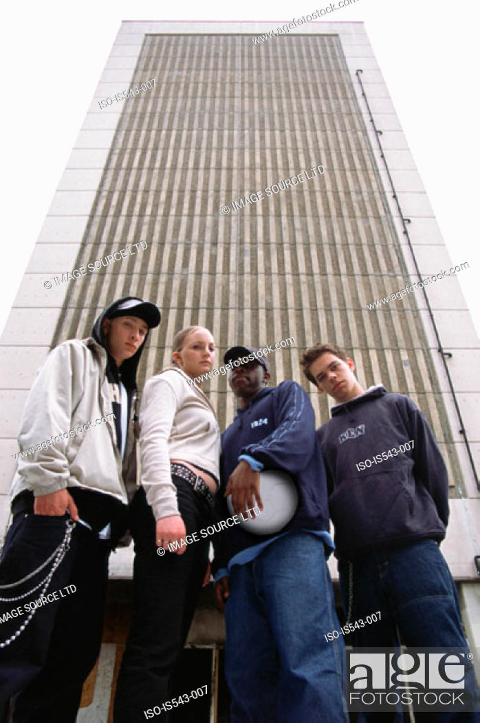 Stock Photo: Teenagers outside multistorey building.