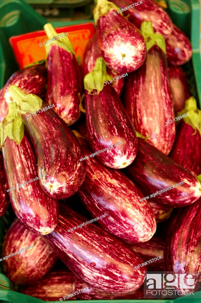 Stock Photo: Fresh aubergines in a market.