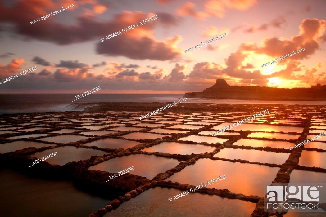 Stock Photo: Sunrise in Salt Pans, Gozo island, Malta.
