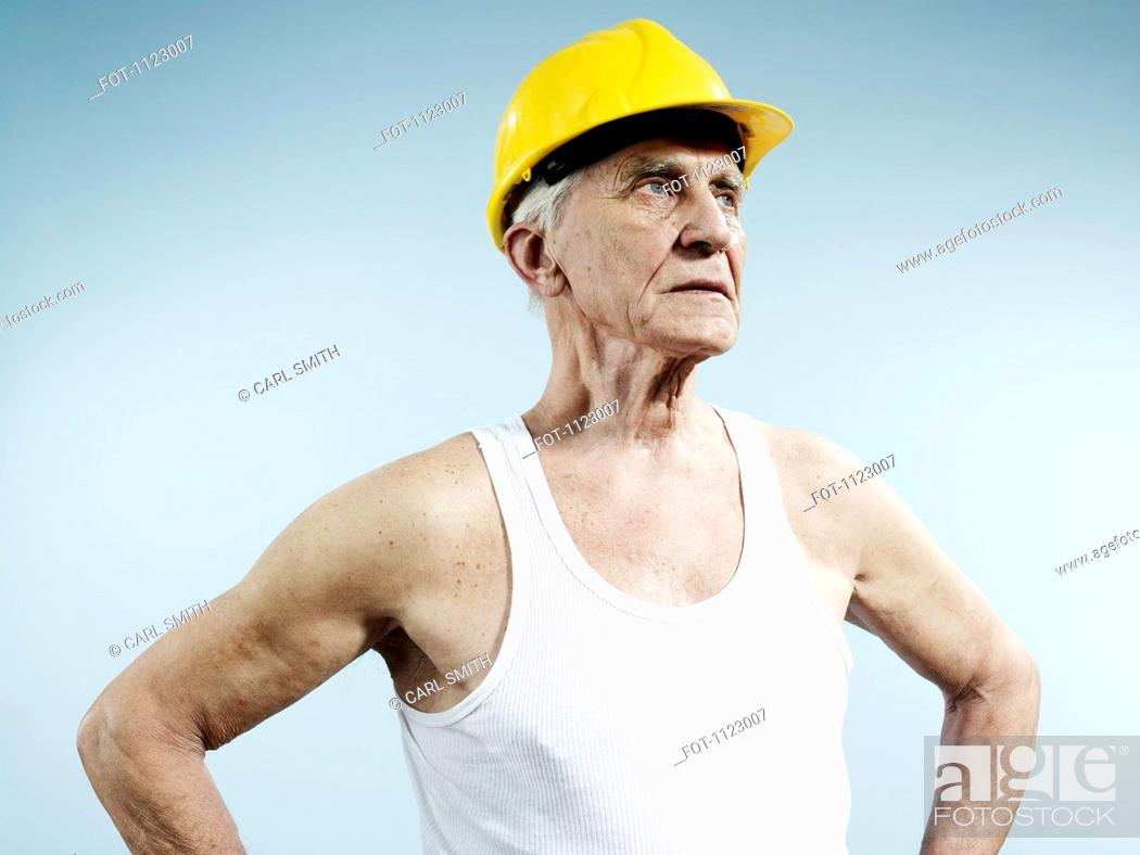 Stock Photo: A senior man wearing a hardhat and tank top.