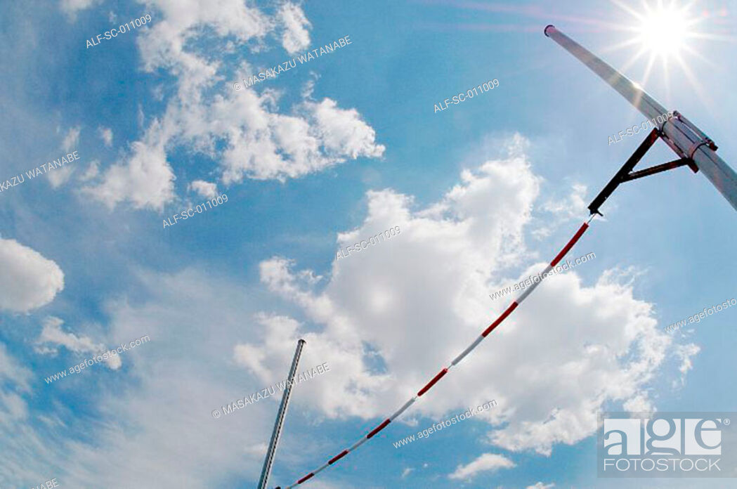Stock Photo: High Jump Bar Glistening In the Sun.