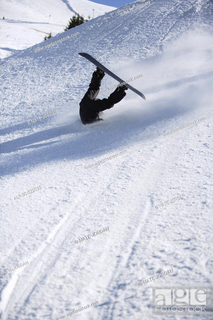Stock Photo: Snowboarder Wiping Out.