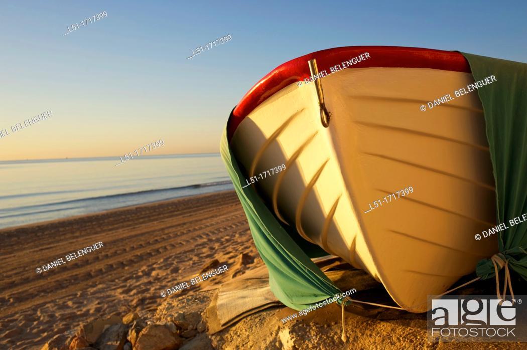Stock Photo: small boat at Santa Pola beach, Salinas de Santa Pola Nature Reserve, Santa Pola, Alicante, Spain.