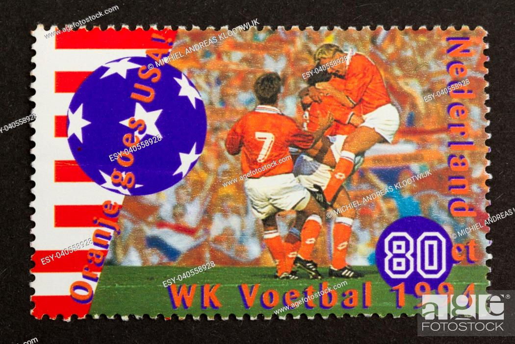 Stock Photo: HOLLAND - CIRCA 1990: Stamp printed in the Netherlands shows a picture of the world championship football in the USA (1994), circa 1990.