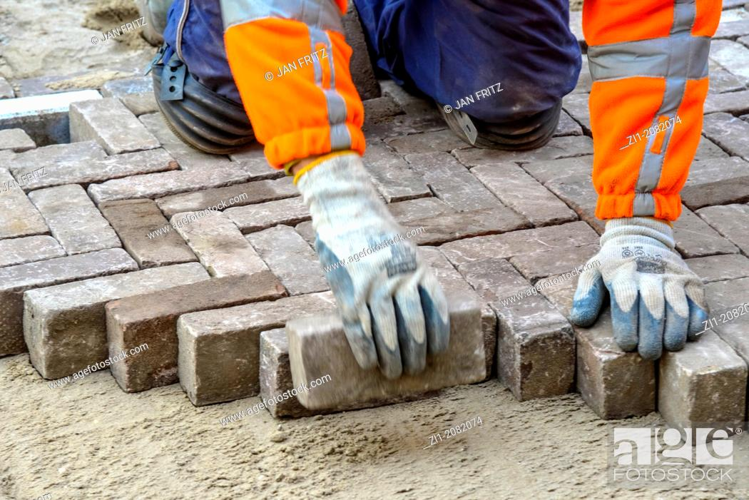Stock Photo: paviour at work in street in the Netherlands.