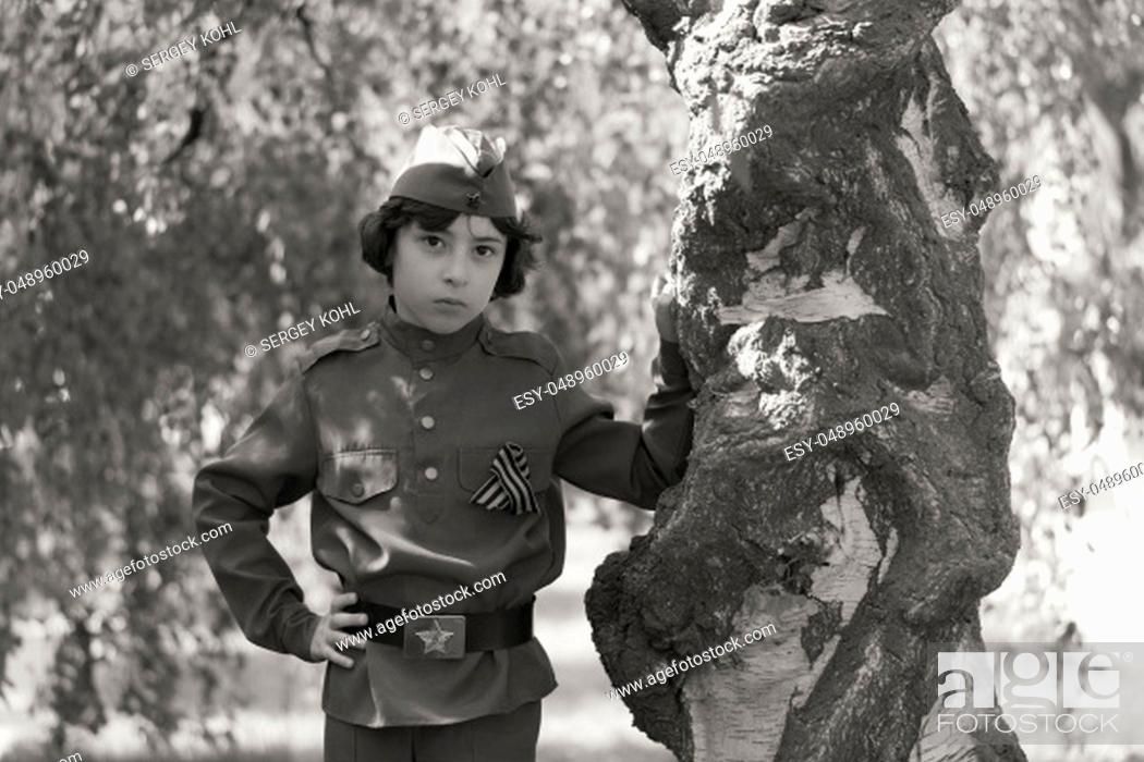 Stock Photo: Portrait of a boy in the uniform of a soldier of the Red Army during the Second World War. Black and white.