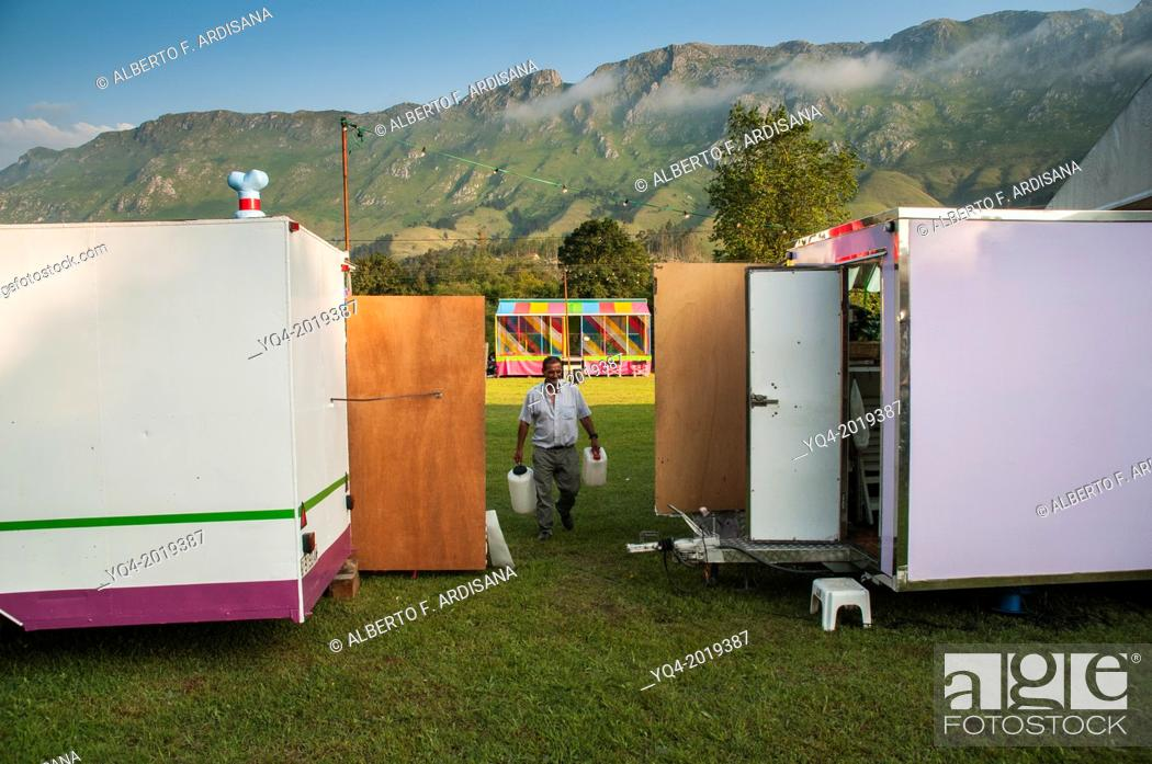 Stock Photo: Composition of a man with two bottles framing by squares. traveling salesman Llanes . Asturias. Spain.