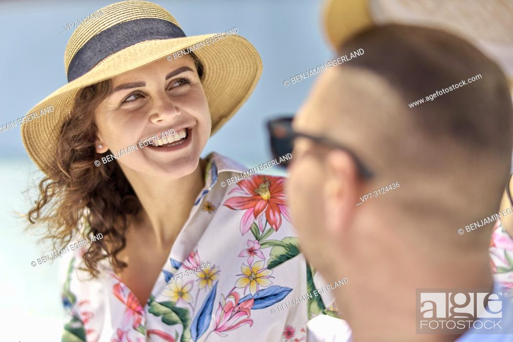 Stock Photo: woman next to man, sunhat, vacations, happiness, toothy smile.