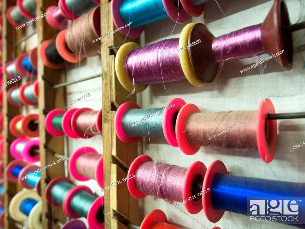 Photo de stock: Colourful threads on rack, Varanasi, Uttar Pradesh, India.