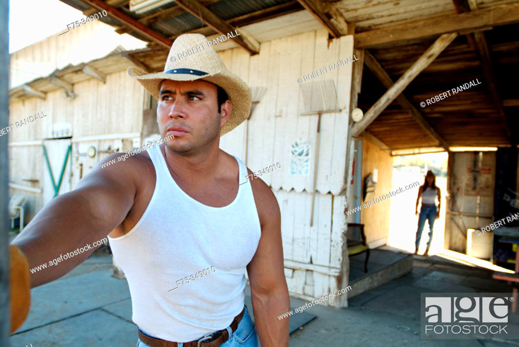 Stock Photo: Rancher looks out towards stables. Poway, California. USA.