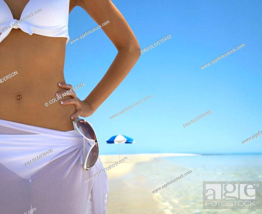 Stock Photo: Woman with hand on hip at beach.