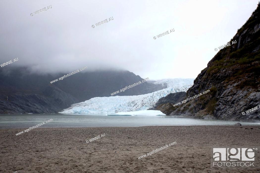 Stock Photo: A distant person standing on a beach near Mendenhall Glacier, Alaska.