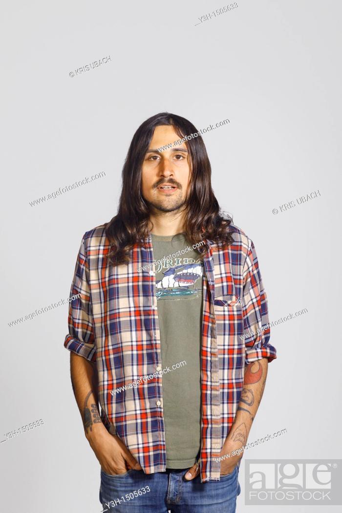 Stock Photo: Studio shot of tattooed man.