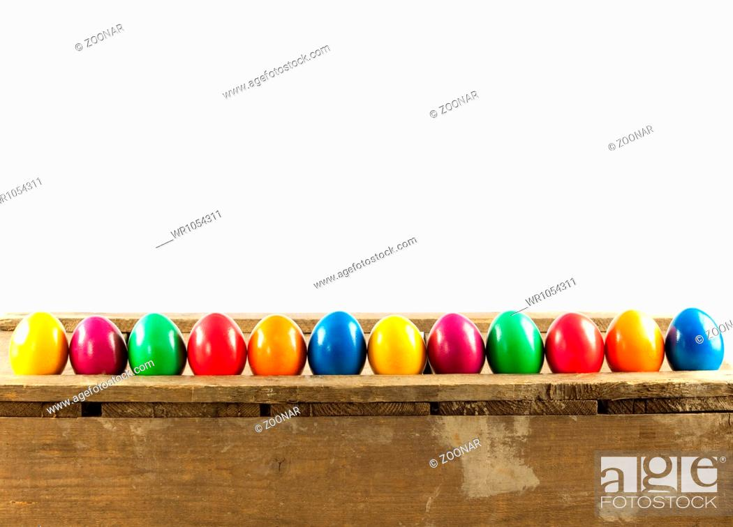 Stock Photo: Colorful easter eggs on old wooden background.
