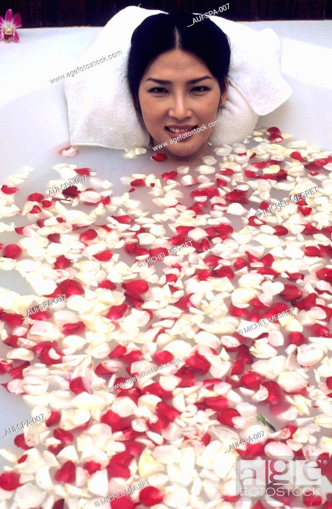 Stock Photo: Spa - Relaxing bath - Milk and honey bath with rose petals.