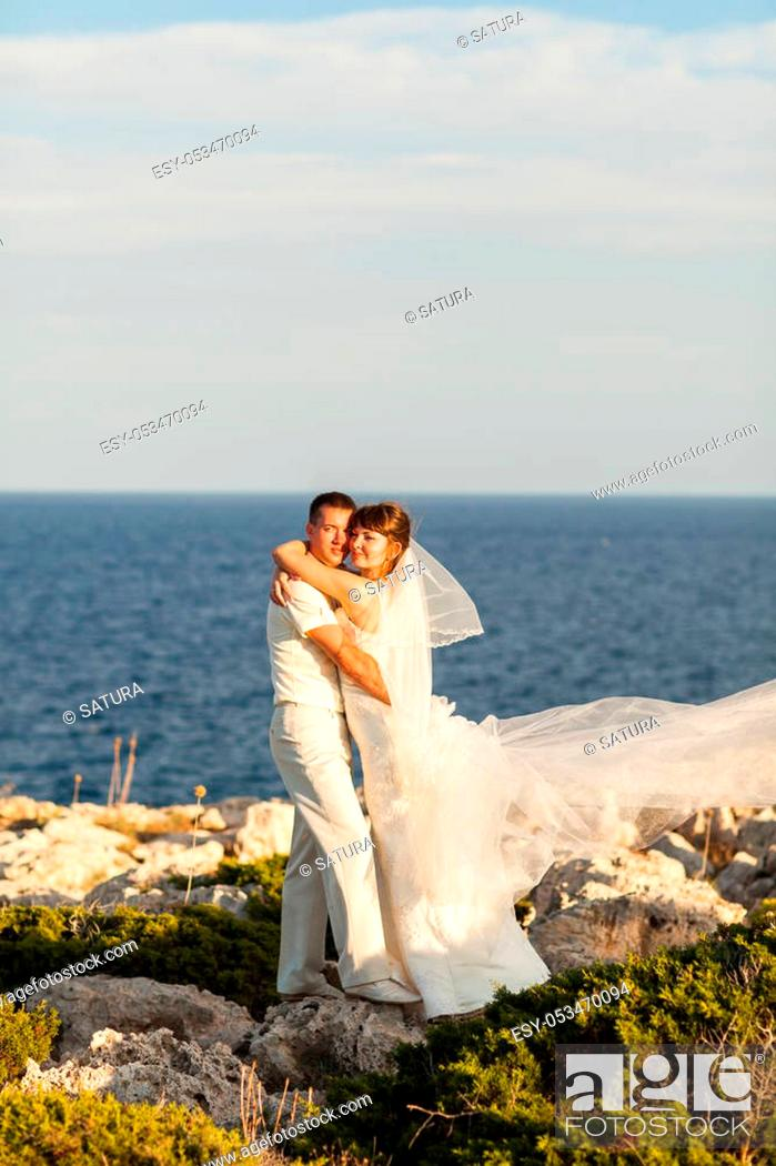 Stock Photo: Bride and groom on a romantic moment on nature. Stylish wedding couple outdoors.